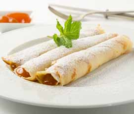 Crepe filled with Apricot jam and topped with powdered sugar